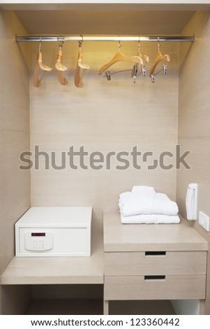 hotel room wardrobe ready for customer.