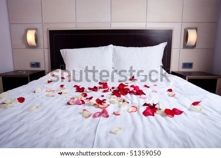 hotel room with big bed and white bedding