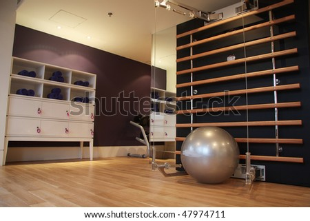 Hotel room with gym equipment