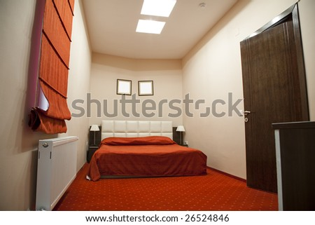 hotel room with red and beige four stars empty