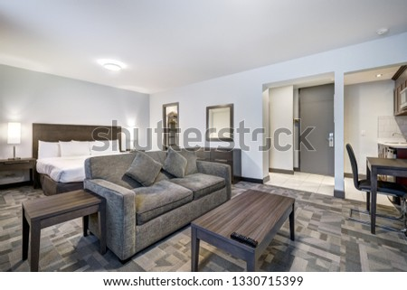 Hotel rooms and interiors with bathrooms and kitchenettes #1330715399