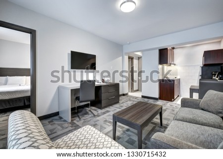 Hotel rooms and interiors with bathrooms and kitchenettes #1330715432