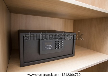 Hotel safe on a shelf with numeric keypad #1212366730