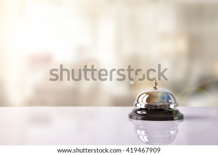 Hotel service bell on a table white glass and simulation hotel background. Concept hotel, travel, room #419467909