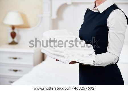 Hotel services. housekeeping maid with linen #463257692