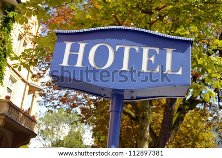 Hotel sign - Hotel signboard with building and trees in the background