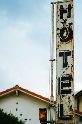 hotel Sign idestroyed by time, concept for   hotel industry and bad accomodation. Flare added version.