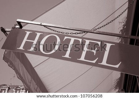 Hotel Sign on Building with Blue Sky Background