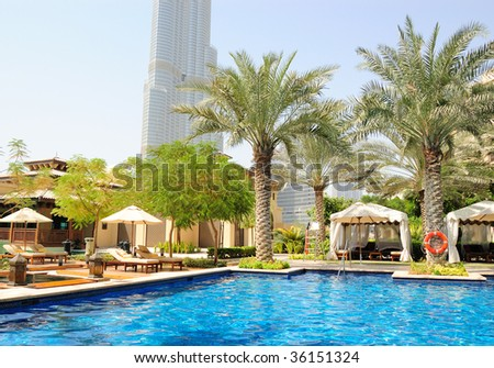 Hotel swimming pool area in Dubai downtown, UAE - stock photo