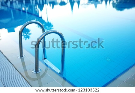 Hotel swimming pool with sunny reflections