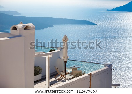 Hotel terrace at Santorini island in Greece with view to the volcanic caldera