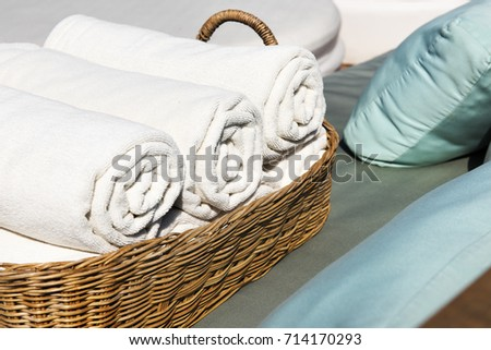 Hotel Towels Rolled in Wooden Basket