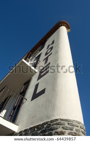 Hotel,without name,against clear blue sky seen from below