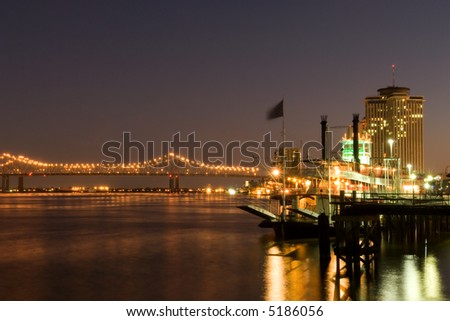 Hotels and bridge over Mississippi river at dusk