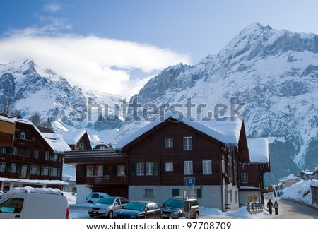 Hotels near the Grindelwald ski area on the mountain. Switzerland. View between of the mountain Schreckhorn and Eiger