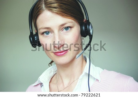 Hotline – Young attractive woman at work