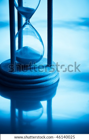 hour-glass with reflection in blue light