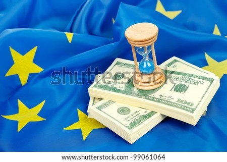 Hour-glass with US dollars on the flag of the EU