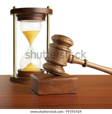 Hourglass and gavel isolated on white