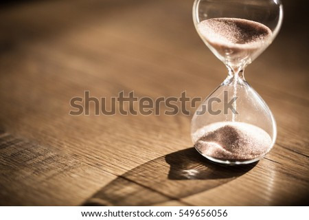 Hourglass as time passing concept for business deadline, urgency and running out of time. #549656056