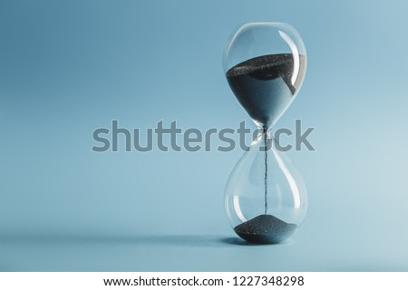 Hourglass on blue background #1227348298