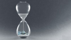 Hourglass on dark background. Concept passing traditional currency time. End of dollar currency. Copy space.