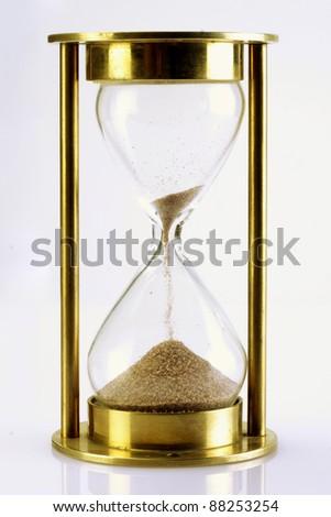 Hourglass on white - stock photo
