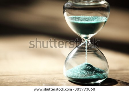 hourglass on wooden background,vintage color tone