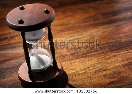 Hourglass or sand timer symbol of time concept with copy space