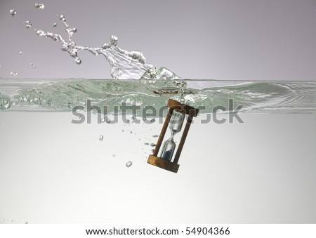 Hourglass submerged into the water.