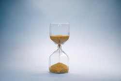 hourglass with golden sand pouring inside, eternal time, infinity, business time
