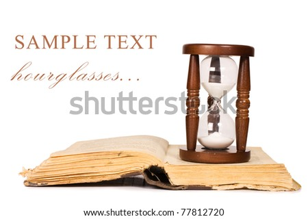 Hourglasses and book isolated on white