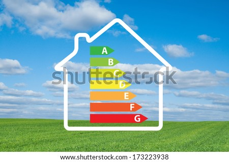 House and energy efficiency graph on  a meadow.