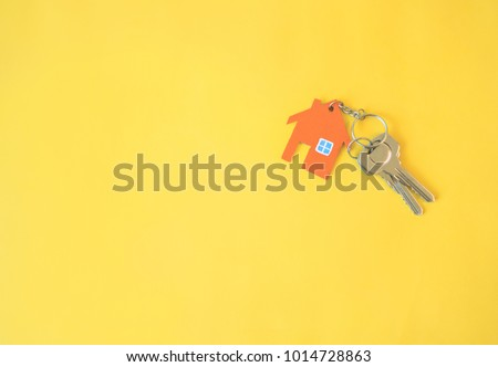 House and key on yellow background. Minimal creative style. #1014728863