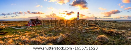 House and Lighthouse in List, Sylt, North Sea, Germany  Stock photo ©