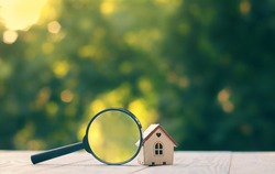house and magnifying glass. House searching concept, choice of location for construction, of mortgage, rental housing. construction, sales, lease. business, economics, investments concept