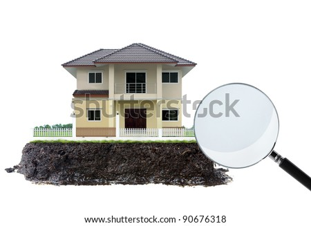 house and magnifying glass, on white - stock photo