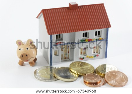 House and money with happiness pigs
