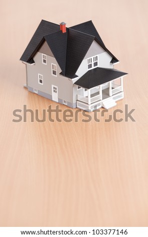 House architectural model on wooden table