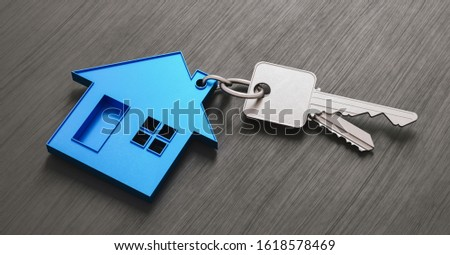 House as a pendant on a key on dark table as a house purchase and housing concept Foto stock ©
