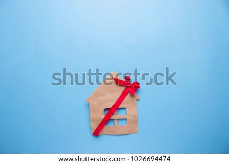 house as a present concept. house with red bow - Shutterstock ID 1026694474