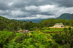 house at remote village isolated with mountain coverd clouds and green forests image is showing the amazing beauty and art of nature. This image is taken at karnataka india.