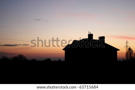 House at sunset - stock photo