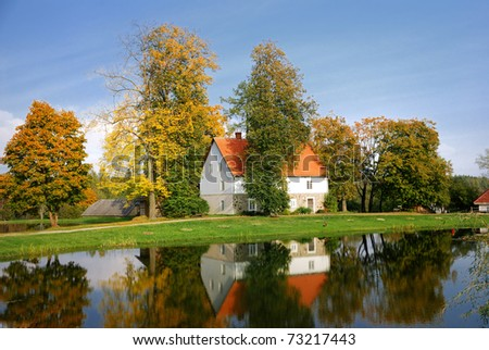 house at the lake bank in autumn. Sigulda, Latvia