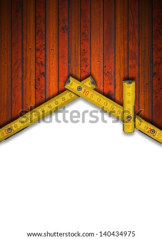 House Background - Wood Meter Tool / Wood Background and wooden yellow meter tool forming a house on white background