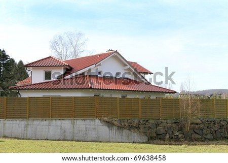 House behind a wooden fence Stock foto ©