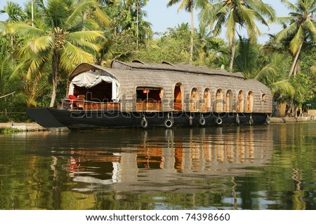 House boat in the Kerala (India) Backwaters. Used to carry rice in the olden days. Now primarily used as houseboats.