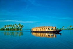 House boat under blue sky from Alleppey or Alappuzha Backwaters of Kerala.Kerala houseboat Photo