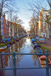 House boats, bridges and houses along the canals of Amsterdam, Netherlands