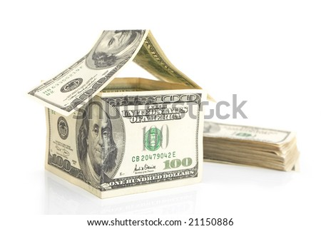 house build from 100 dollar bills isolated against white background